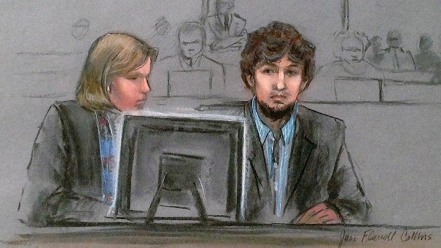 March 9, 2015: In this courtroom sketch, Dzhokhar Tsarnaev, right, and defense attorney Judy Clarke are depicted watching evidence displayed on a monitor during his federal death penalty trial.