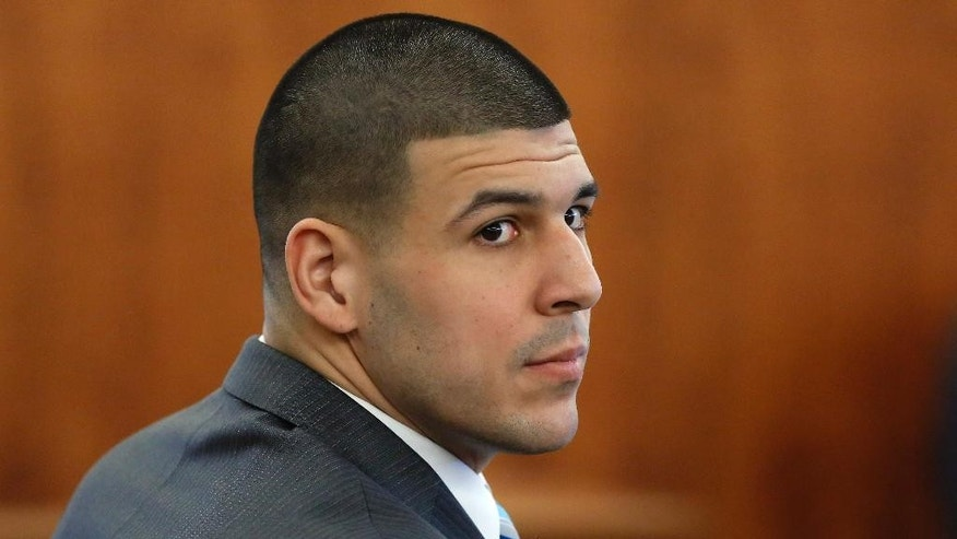 Former New England Patriots football player Aaron Hernandez sits during his murder trial Thursday, March 19, 2015, in Fall River, Mass. Hernandez is charged with killing semiprofessional football player Odin Lloyd. (AP Photo/Steven Senne, Pool)