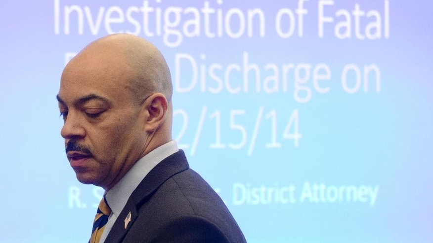 Philadelphia District Attorney Seth Williams arrives for a news conference Thursday, March 19, 2015, in Philadelphia. Williams says the fatal December 2014 police shooting of  Brandon Tate-Brown during an early morning traffic stop was a tragedy but not a crime. (AP Photo/Matt Rourke)