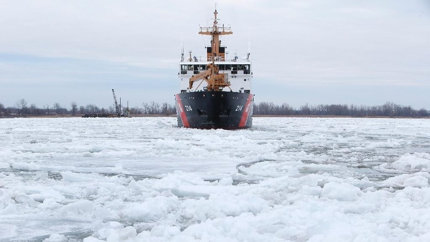 The U.S. Coast Guard's 225-foot Seagoing Buoy Tender Hollyhock breaks up ice that remains on some Great Lakes shipping channels in the St. Clair River near Algonac, Mich., Friday, March 20, 2015. (AP Photo/Paul Sancya)
