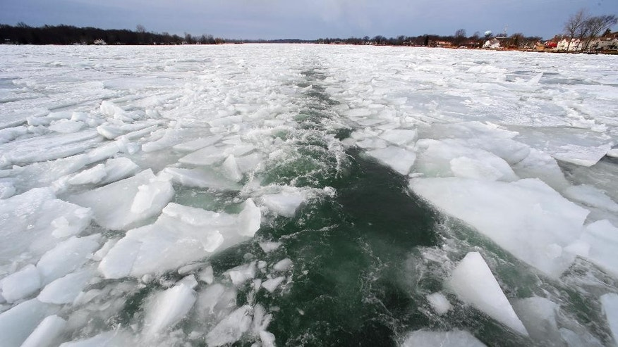 The U.S. Coast Guard's 140-foot icebreaking cutter Bristol Bay leaves a path as it breaks up ice that remains on some Great Lakes shipping channels in the St. Clair River near Algonac, Mich., Friday, March 20, 2015. (AP Photo/Paul Sancya)
