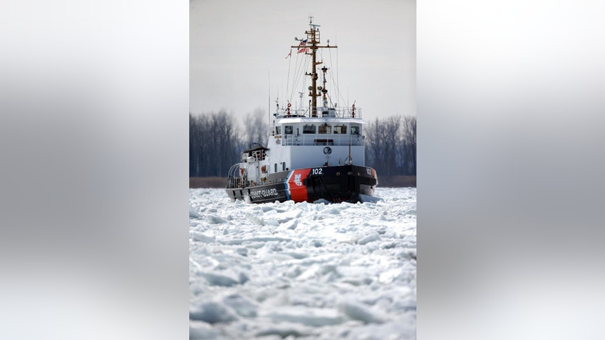 The U.S. Coast Guard's 140-foot icebreaking cutter Bristol Bay breaks up ice that remains on some Great Lakes shipping channels in the St. Clair River near Algonac, Mich., Friday, March 20, 2015. (AP Photo/Paul Sancya)