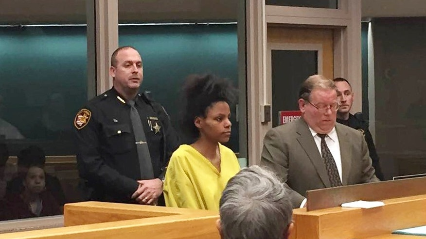Deasia Watkins appears in Hamilton County Municipal Court on Friday, March 20, 2015 in Cincinnati.  Judge Melissa Powers has set bail for Watkins at $500,000. Watkins was charged with aggravated murder after her daughter's body was found Monday on a kitchen counter in an aunt's home. Authorities say 3-month-old Jayniah Watkins had been decapitated and stabbed multiple times with a large chef's knife. Police found Watkins in bed covered with blood. (AP Photo/The Cincinnati Enquirer, Henry Molski/)  MANDATORY CREDIT;  NO SALES