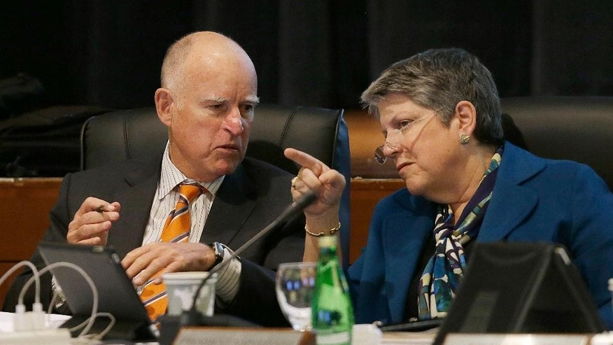 "FILE - In this March 18, 2015 file photo, University of California president Janet Napolitano talks with Gov. Jerry Brown during a UC Board of Regents meeting in San Francisco. Napolitani publicly apologized Thursday, March 19, 2015, for calling chants by students protesting tuition hikes ""crap,"" a remark overheard on an open microphone at the regents meeting Wednesday.  (AP Photo/Jeff Chiu, File)"