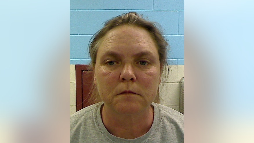 "FILE - This file photo released by the Etowah County Sheriff's Dept. on Wednesday, Feb. 22, 2012 shows Joyce Hardin Garrard, 46. A jury convicted 49-year-old Joyce Hardin Garrard late Friday March 20. 2015 in the February 2012 death of Savannah Hardin, siding with prosecutors who depicted Garrard as a ""drill sergeant from hell,"" a domineering taskmaster so enraged over a lie about candy that she made the girl run until she dropped. The sentencing phase _ a mini-trial within the trial _ is to begin Monday, the judge said.  (AP Photo/Etowah County Sheriff's Office)"