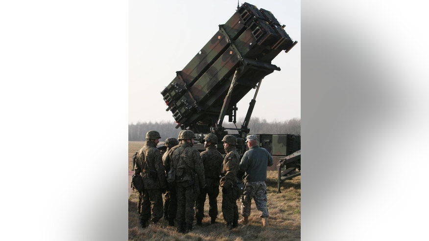 U.S. troops from 5th Battalion of the 7th Air Defense Regiment are seen at a test range in Sochaczew, Poland, on Saturday, March 21, 2015 as part of joint exercise with Poland's troops of the 37th Missile Squadron of Air Defense that is to demonstrate the U.S. Army's capacity to deploy Patriot systems rapidly within NATO territory. The training is a part of a wider Atlantic Resolve operation being held at a time of armed conflict across NATO's eastern border, in Ukraine and also involving Russia.(AP Photo/Czarek Sokolowski)