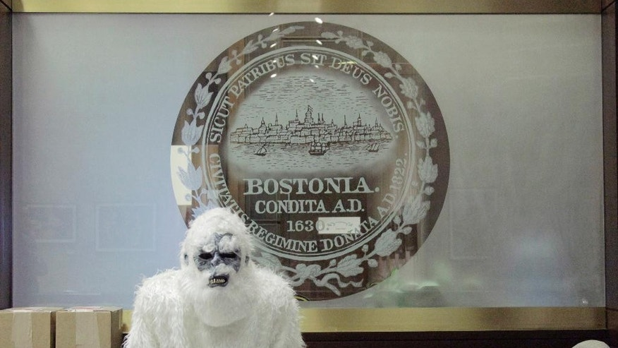 March 6, 2015: In this file photo provided by Eric Gulliver, an anonymous creature known as The Boston Yeti poses in front of the Boston logo at City Hall in Boston.