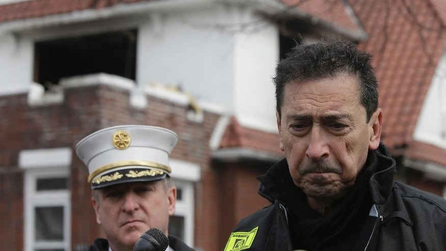 New York's Fire Commissioner Daniel Nigro, right, speaks to reporters during a news conference in front of the scene of a fatal fire in the Brooklyn borough of New York, Saturday, March 21, 2015. The fire raged through the residence early Saturday, killing seven children and leaving two other people in critical condition, authorities said.(AP Photo/Mary Altaffer)