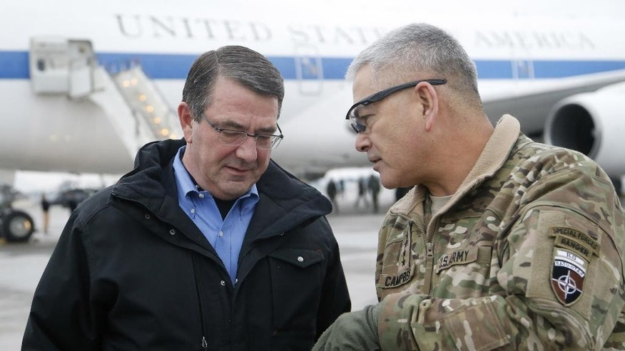 FILE - In this Feb. 21, 2015, file photo, U.S. Secretary of Defense Ash Carter, left, walks with U.S. Army Gen. John Campbell upon arrival at Hamid Karzai International Airport in Kabul, Afghanistan. The pace of U.S. troop withdrawals from Afghanistan will headline Afghan President Ashraf Ghani's visit to Washington(AP Photo/Jonathan Ernst, Pool)