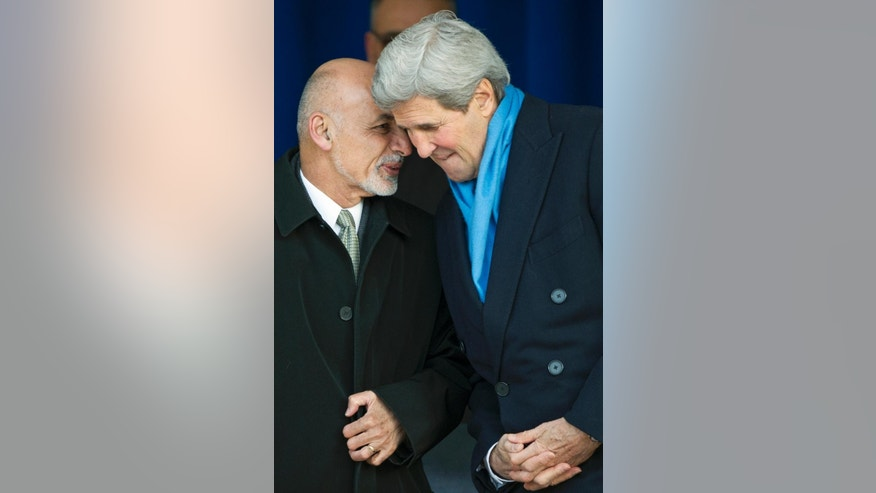 Afghanistan President Ashraf Ghani speaks with Secretary of State John Kerry at the Pentagon, Monday, March 23, 2015.  President Ghani made remarks to service members and veterans who have served in Afghanistan to thank them for their continued efforts and sacrifices.(AP Photo/Cliff Owen)