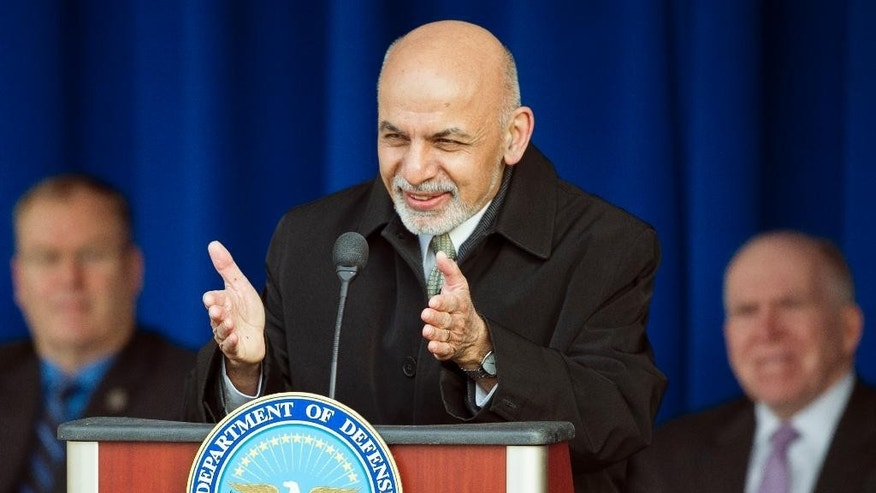 Afghanistan President Ashraf Ghani speaks at the Pentagon, Monday, March 23, 2015. In a ceremony at the Pentagon, Afghanistan's president thanked U.S. troops and taxpayers for their sacrifices in nearly 14 years of war. (AP Photo/Cliff Owen)