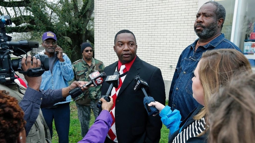 Marcus Turner speaks to reporters as a small group of concerned residents and friends of Otis Byrd gather in downtown Port Gibson, Miss., Monday, March 23, 2015 during a rally to show support for the Byrd's family and to call on federal and state authorities to do a thorough investigation into his death. Byrd's body was found Thursday, hanging from a sheet from a tree in a rural area outside of Port Gibson. The FBI is consulting with its behavioral analysis unit as it continues investigating the hanging death of Byrd. Elmo Cooper, right, a classmate of theirs, also spoke. (AP Photo/Rogelio V. Solis)