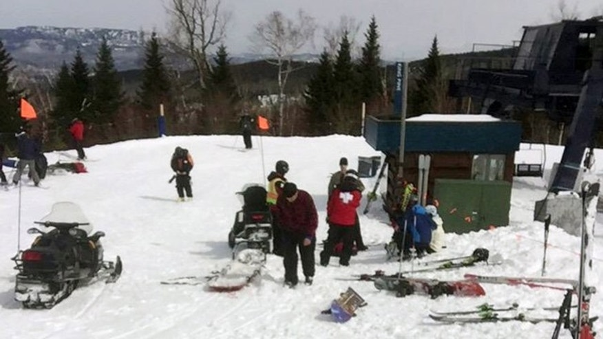 March 21, 2015: In this photo provided by Greg Hoffmeister, first aid is administered to injured skiers at Sugarloaf Mountain Resort after a chairlift accident in Carrabassett Valley, Maine. Seven people were hurt when an out-of-control chair lift at Sugarloaf ski resort stopped and then headed down the mountain backward, prompting riders to jump off, officials and witnesses said. (AP Photo/Greg Hoffmeister)