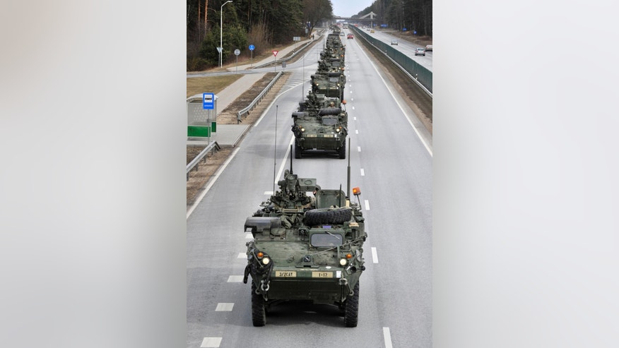Stryker vehicles of the US Army's 2nd Cavalry Regiment roll down the highway, during the ''Dragoon Ride'' military exercise,  in Riga, Latvia, Sunday, March 22, 2015. The troops began the trek on March 21, and will travel through Latvia, The Czech Republic and onto Germany by April 1 in an exercise designed to reinforce America's allies. (AP Photo/Oksana Dzadan)