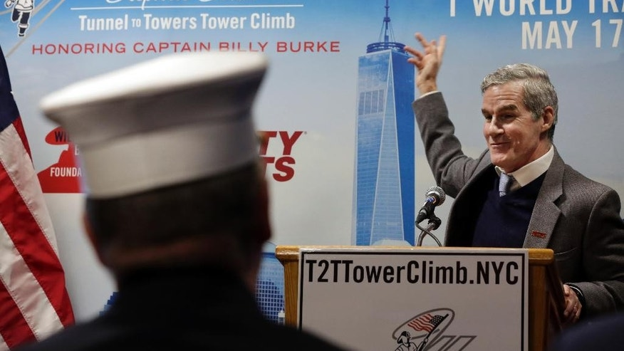Michael Burke, board member of the Capt. Billy Burke Foundation, addresses a news conference at the firehouse of Engine Company 21, in New York,  Monday, March 23, 2015. The first stair-climb benefit will be held at One World Trade Center in May to raise money for military veterans, two foundations, the Stephen Siller Tunnel to Towers Foundation and the Captain Billy Burke Foundation, formed after the 9/11 attacks announced Monday. (AP Photo/Richard Drew)