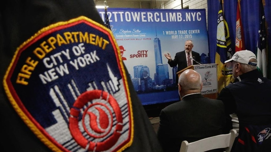 Frank Siller, chairman and CEO of the Stephen Siller Tunnel to Towers Foundation, addresses a news conference at the firehouse of Engine Company 21, in New York, Monday, March 23, 2015. The first stair-climb benefit will be held at One World Trade Center in May to raise money for military veterans, two foundations, the Stephen Siller Tunnel to Towers Foundation and the Captain Billy Burke Foundation, formed after the 9/11 attacks announced Monday. (AP Photo/Richard Drew)