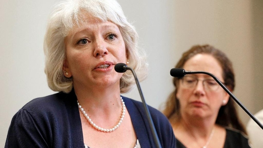 Debra Milke speaks, Tuesday, March 24, 2015, in Phoenix. Milke spoke out for the first time after spending two decades on death row in the killing of her son. Her case was dismissed earlier this week. (AP Photo/Matt York)