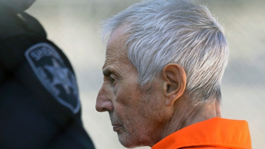 March 17, 2015: Robert Durst is escorted into Orleans Parish Prison after his arraignment in Orleans Parish Criminal District Court in New Orleans. (AP Photo/Gerald Herbert, File)