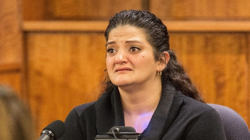 Witness Jennifer Mercado, a cousin of defendant Aaron Hernandez, becomes emotional as she testifies during the murder trial of the former New England Patriots NFL football player at Bristol County Superior Court, Tuesday, March 24, 2015, in Fall River, Mass. Hernandez is charged with killing semiprofessional football player Odin Lloyd in June 2013. (AP Photo/The Boston Globe, Aram Boghosian, Pool)