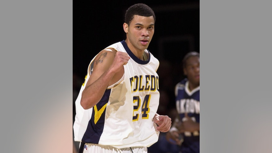 In this Jan. 18, 2004 photo, University of Toledo basketball player Sammy Villegas pumps his fist during an NCAA basketball game in Toledo, Ohio. Villegas, who accepted at least $3,000 from a gambler to miss shots and make other mistakes, was sentenced to probation Tuesday, March 24, 2015 in a decade-old point-shaving scandal. (AP Photo/The Blade, Andy Morrison) MANDATORY CREDIT  MAGS OUT NO SALES  TV OUT  BOWLING GREEN SENTINEL-TRIBUNE OUT  THE MONROE EVENING NEWS OUT  TOLEDO FREE PRESS OUT
