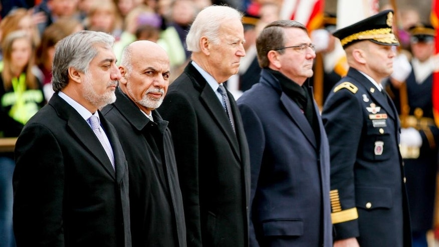 From left, Afghanistan's Chief Executive Officer Abdullah Abdullah, Afghanistan's President Ashraf Ghani, Vice President Joe Bidden, Defense Secretary Ash Carter, and Maj. Gen. Jeffrey Buchanan, commanding general, U.S. Army Military District of Washington, stand together during a wreath laying ceremony at the Tomb of the Unknowns, Tuesday, March 24, 2015, at Arlington National Cemetery in Arlington, Va. (AP Photo/Andrew Harnik)