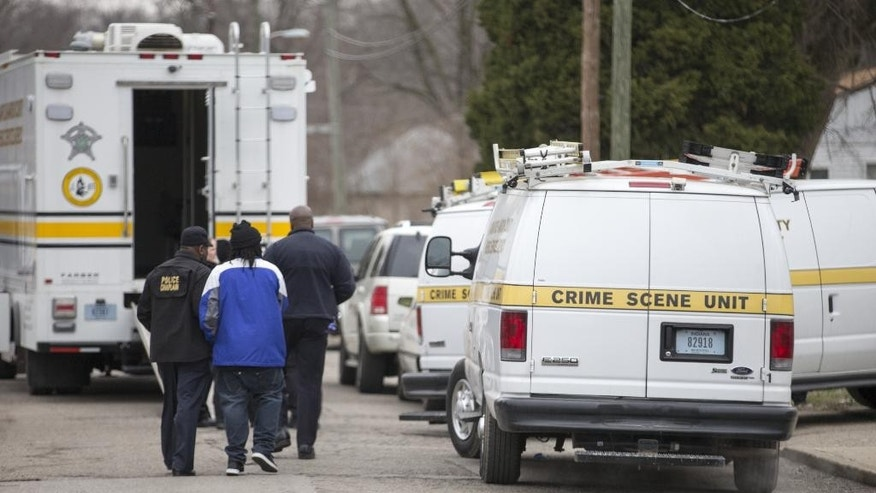 Indianapolis Metropolitan Police Department personnel investigate a scene involving four homicide victims at a house on North Harding Street, Tuesday, March 24, 2015, in Indianapolis. Indianapolis Police Chief Rick Hite says three women and a man have been shot to death in the home. Hite says the shootings don't appear random and likely occurred Tuesday morning. (AP Photo/The Indianapolis Star, Robert Scheer)
