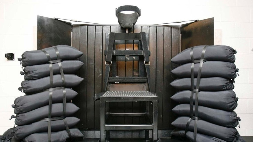 "FILE - This June 18, 2010, file photo shows the firing squad execution chamber at the Utah State Prison in Draper, Utah. Utah's governor has signed a law that makes his state the only one to allow firing squads for carrying out executions if no lethal injection drugs are available. Gov. Gary Herbert signed the bill Monday, March 23, 2015. He has said he finds the method ""a little bit gruesome,"" but that it gives the state a fallback execution method. (AP Photo/Trent Nelson, Pool, File)"