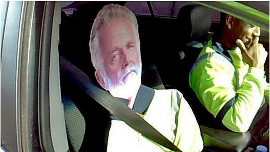 """This Monday, March 23, 2015 photo by Washington State Patrol Trooper Tony Brock shows a cardboard cutout of the """"The Most Interesting Man In The World,"""" otherwise known as actor Jonathan Goldsmith, of Dos Equis beer TV commercial fame, strapped to the passenter seat of a driver who tried to use the image to qualify to drive the carpool lane on Interstate 5 near Fife, Wash. The trooper says it's by far the best carpool scam he's seen, but it didn't work. Both were chuckling as the driver, whose name wasn't released, said """"He's my best friend."""" The Most Interesting Man was not confiscated, but the driver was told not to use him again. The State Patrol tweeted the photo, saying: """"I don't always violate the HOV lane law ... but when I do, I get a $124 ticket."""" (AP Photo/Washington State Patrol, Trooper Tony Brock)"""