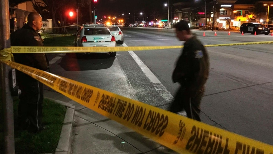 March 24, 2015: Law enforcement officers have an area blocked off as they search for a suspect in the fatal shooting of a San Jose, Calif., police officer.