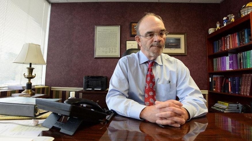 In a March 19, 2015 photo, A.M. Stroud III, a former prosecutor and lead attorney in the Glenn Ford case, sits for an interview with The Times of Shreveport in his Shreveport, La., office. Stroud III drew national attention over the weekend with an anguished, open letter of apology published in the paper. (AP Photo/The Shreveport Times, Douglas Collier) MAGS OUT; MANDATORY CREDIT SHREVEPORTTIMES.COM;  NO SALES