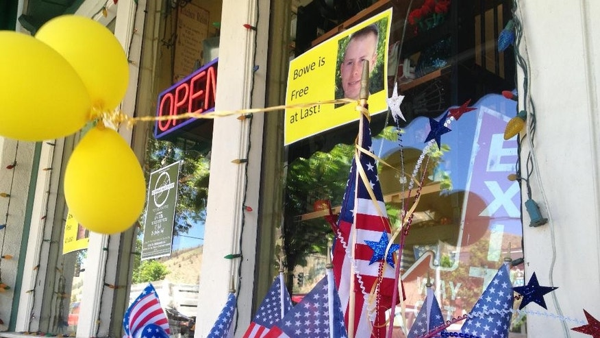 FILE - In this June 4, 2014 file photo, flags and balloons marking the release from captivity of Sgt. Bowe Bergdahl adorn the sidewalk outside a shop in the soldier's hometown of Hailey, Idaho. The Army sergeant who abandoned his post in Afghanistan and was held captive by the Taliban for five years will be court martialed on charges of desertion and avoiding military service, a U.S. official said Wednesday, March 25, 2015. (AP Photo/Brian Skoloff, File)