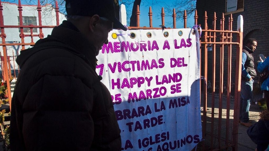 Pablo Blanco, right, stands next to the memorial site for victims of the March 25, 1990, Happy Land social club fire, during an interview, Tuesday, March 24, 2015, in the Bronx borough of New York. Blanco, whose favorite uncle was among the 87 victims of an arsonist, will join a memorial Mass and vigil at the site to mark the 25th anniversary of what was then the biggest mass murder in modern U.S. history. (AP Photo/Bebeto Matthews)