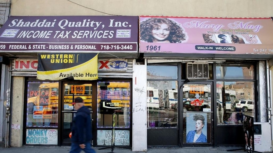 A salon stands in the location of the former Happy Land Social Club, in the Bronx borough of New York, Thursday, March 19, 2015. A March 25, 1990, fire in the club killed 87 people. (AP Photo/Seth Wenig)