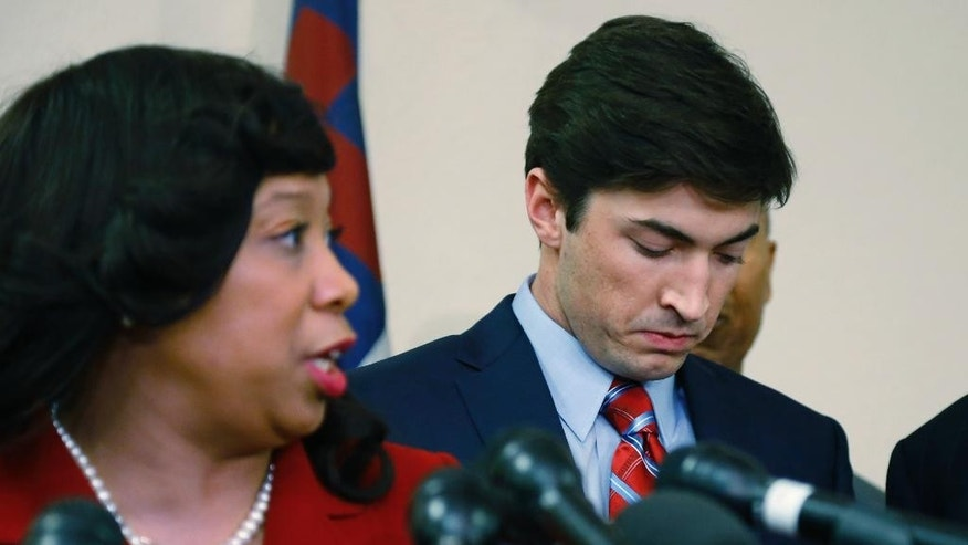 Levi Pettit, right, a former University of Oklahoma fraternity member caught on video leading a racist chant, waits to be introduced at a news conference by Oklahoma state Sen. Anastasia Pittman, left, D-Oklahoma City, in Oklahoma City, Wednesday, March 25, 2015.  Pettit said Wednesday he's deeply sorry for his role in the incident and upset and embarrassed that he failed to stop it. (AP Photo/Sue Ogrocki)