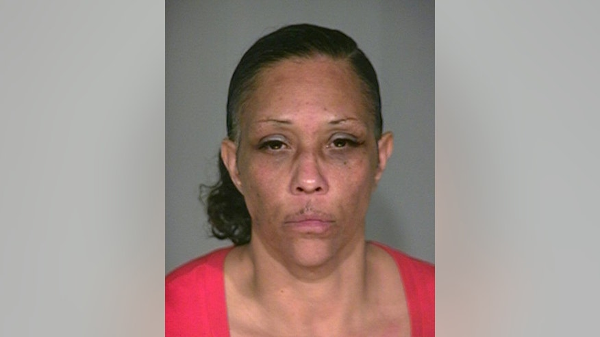 In this provided by the Indianapolis Metropolitan Police Department is Sherry Taylor, 48, of Indianapolis. Police said Wednesday, March 25, 2015 that Taylor is one of four victims found fatally shot in a house in a high-crime neighborhood in Indianapolis on Tuesday. (AP Photo/Indianapolis Metropolitan Police Departmen, ho)