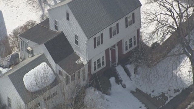 Police say suburban Boston home was wired to explode with flip of a switch