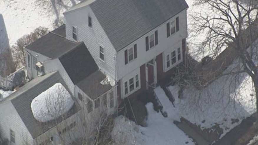 March 25, 2015: A view of a home in Milton, Mass. that investigators say contained a device wired to blow up when a light switch was turned on. (MyFoxBoston.com)