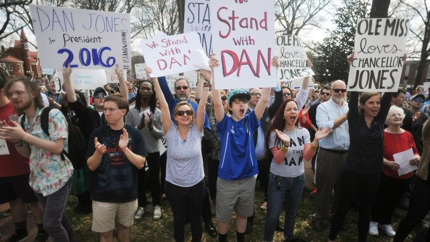 Supporters of University of Mississippi Chancellor Dan Jones rally in the Circle on campus, in Oxford, Miss., on Wednesday, March 25, 2014. Last week, Mississippi's Board of Trustees of State Institutions of Higher Learning declined to renew Jones' contract, which expires in September.  (AP Photo/The Oxford Eagle, Bruce Newman)  NO SALES
