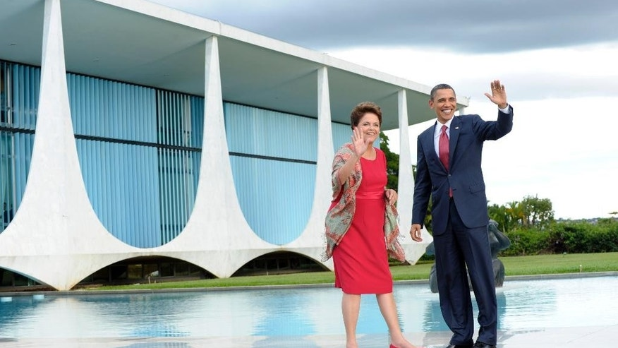 FILE - In this March 19, 2011, file photo, U.S. President Barack Obama walks with Brazilian President Dilma Vana Rousseff as he arrives at the Palacio do Alvorada in Brasilia, Brazil. Brazilian President Dilma Rousseff's office said on Tuesday, March 25, 2015, that she has again been invited to make a state visit to Washington, two years after she declined a similar invitation to protest an American spy program. (AP Photo/Susan Walsh, File)