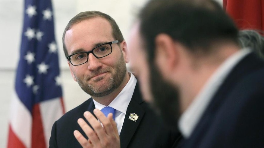 Chad Griffin, national president of the Human Rights Campaign, applauds speakers during a news conference at the Arkansas state Capitol in Little Rock, Ark., Thursday, March 26, 2015. Griffin and other participants at the event called upon Arkansas Gov. Asa Hutchinson to veto a religious protection measure that opponents have said would open the door to state-sanctioned discrimination against gays and lesbians. (AP Photo/Danny Johnston)