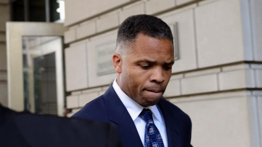 FILE - In this Aug. 14, 2013, file photo, former Illinois Rep. Jesse Jackson Jr., leaves federal court in Washington after being sentenced to 2 1/2 years in prison for misusing $750,000 in campaign funds. Jackson Jr. will be released from a federal prison on Thursday, March 26, 2015, and will serve out the remainder of his term in a Washington, D.C., halfway house, former U.S. Rep. Patrick Kennedy told The Associated Press after visiting Jackson behind bars. (AP Photo/Susan Walsh, File)