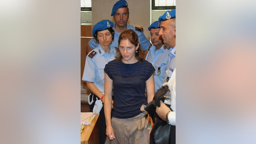 FILE -- In this June 27, 2011 file photo, Amanda Knox is escorted by Penitentiary guards, as she arrives for the appeal hearing, in Perugia, Italy. American Amanda Knox and her Italian ex-boyfriend Raffaele Sollecito expect to learn their fate Friday when Italy's highest court hears their appeal of their guilty verdicts in the brutal 2007 murder of Knox's British roommate Meredith Kercher. Several outcomes are possible, including confirmation of the verdicts, a new appeals round, or even a ruling that amounts to an acquittal in the sensational case that has captivated audiences on both sides of the Atlantic. (AP Photo/Stefano Medici)