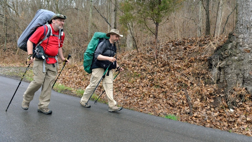 March 26, 2015: Curtis Penix, left and his walking partner Givan Fox walk Kentucky State Road 388 following the Boone Trace near Fort Boonesborough, Ky.