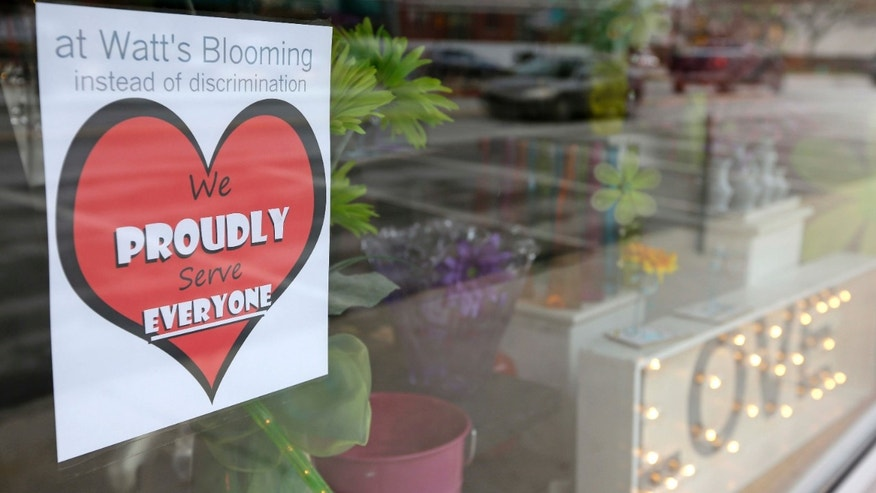 March 25, 2015: A window sign on a downtown Indianapolis florist.