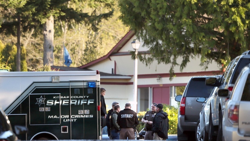 March 28, 2015: Kitsap County Sheriffs deputies and detectives gather to investigate the early Saturday morning shooting of three people, two fatal, at the Kariotis Community mobile home park off McWilliams Rd. in East Bremerton, Wash.