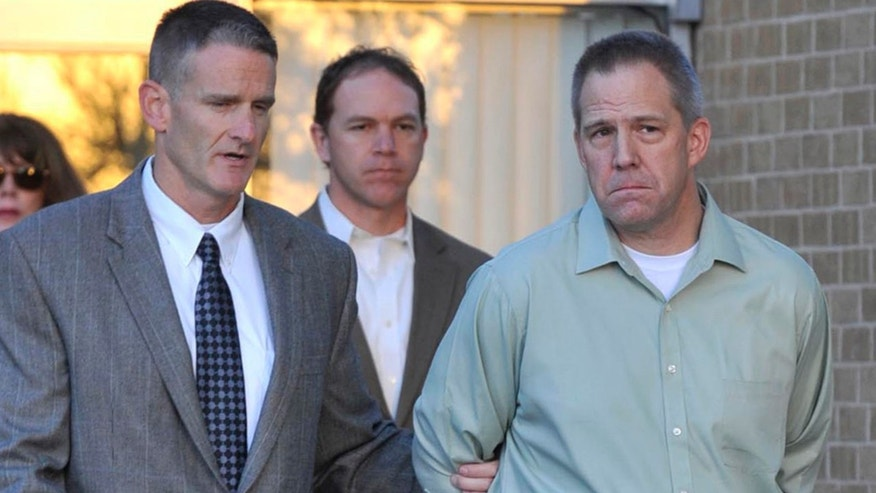 April 2, 2012: In this file photo JetBlue pilot Clayton Frederick Osbon, right, is escorted to a waiting vehicle by FBI agents as he is released from The Pavilion at Northwest Texas Hospital, in Amarillo, Texas.