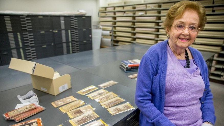 March 27, 2015: Texas stereoscopic photography collector Robin Stanford poses for a photograph next to some of her rare Civil War-era stereoscopic photographs at the Library of Congress in Washington.