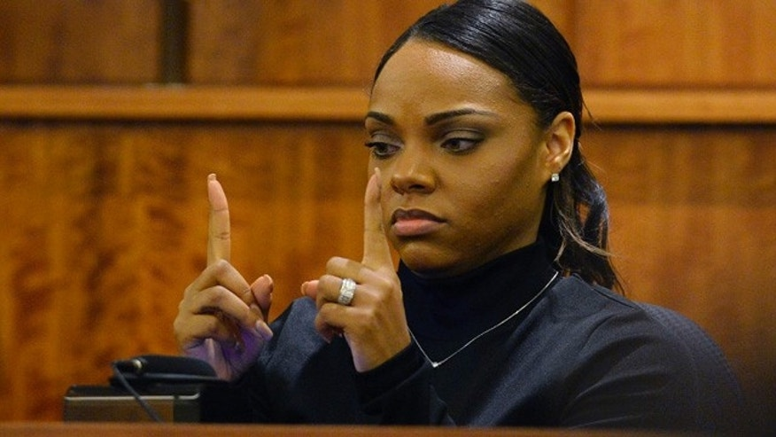 March 27, 2015: Shayanna Jenkins, fiancee of former New England Patriots football player Aaron Hernandez, shows the approximate size of a gun she saw in a kitchen drawer in the home where she and Hernandez lived, as she testifies during his murder trial in Fall River, Mass. (AP Photo/CJ Gunther, Pool)