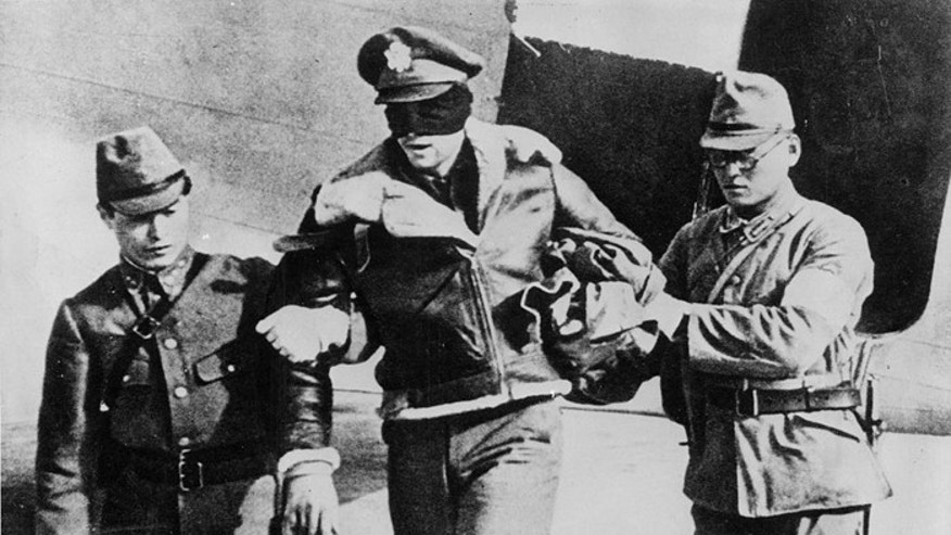 Lt. Col. Robert Hite, shown here being led blindfolded by his captors, was held for 40 months.