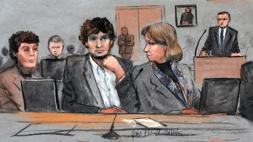 March 5, 2015: In this file courtroom sketch, Dzhokhar Tsarnaev, center, is depicted between defense attorneys Miriam Conrad, left, and Judy Clarke, right, during his federal death penalty trial in Boston.